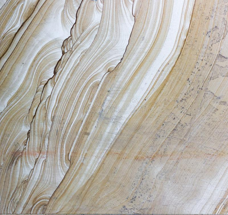 Surface of decorative stone material texture background. Background surface of decorative stone, sandstone with lines, volcanic material for cladding. The stock images