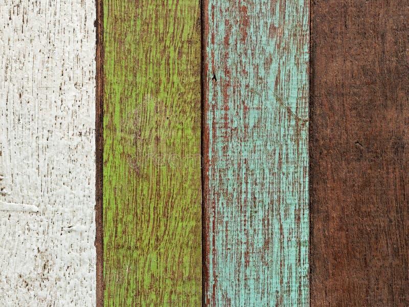 Surface en bois colorée de table peinte avec la couleur blanche, verte, bleue, et brune dans le vintage et le rétro style photos stock