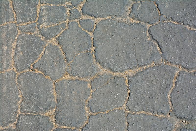 Grey cracked asphalt background. Surface of grey cracked asphalt background royalty free stock photos