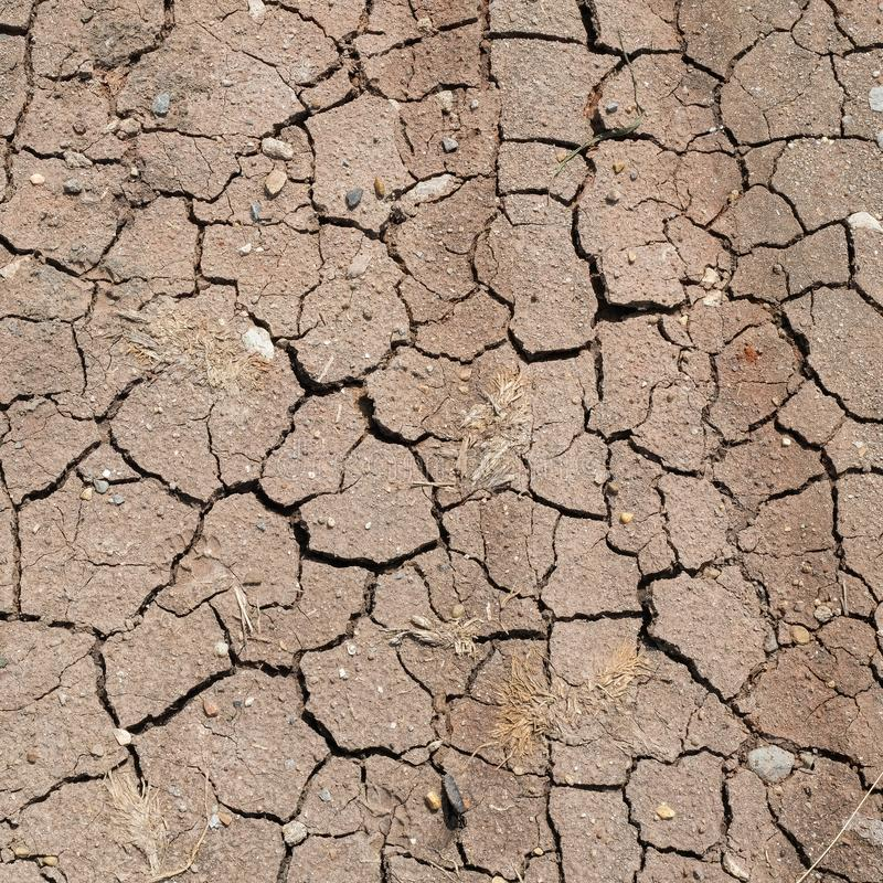 Surface of a grungy dry cracking parched earth. For texture background stock photo