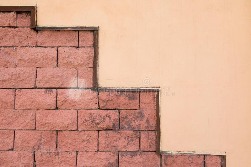 Wall half beige painted and half red tiled stock image