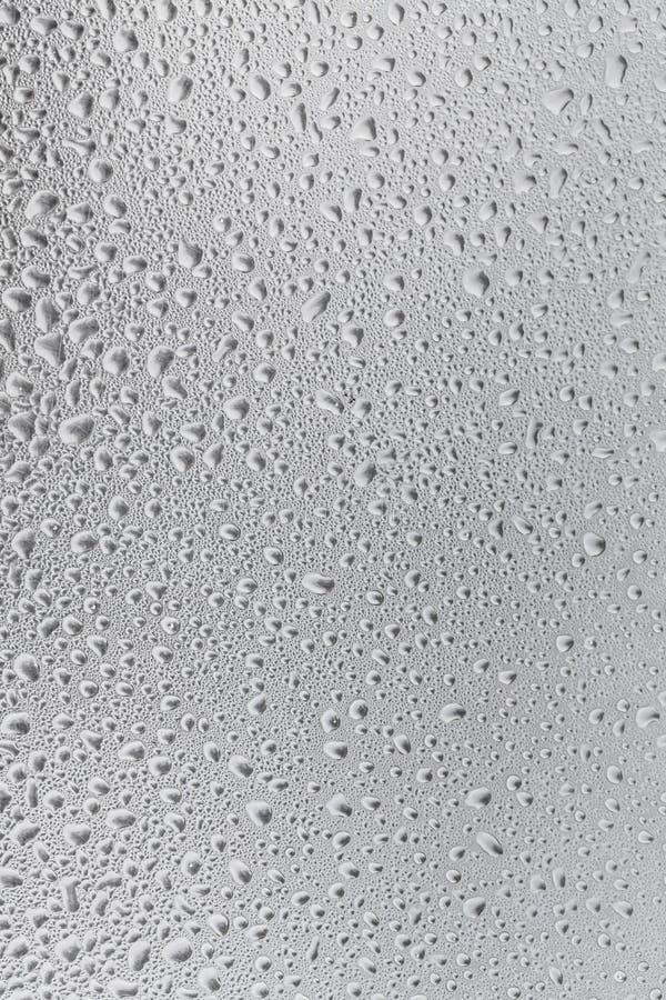 Surface métallique couverte dans des baisses de l'eau image libre de droits