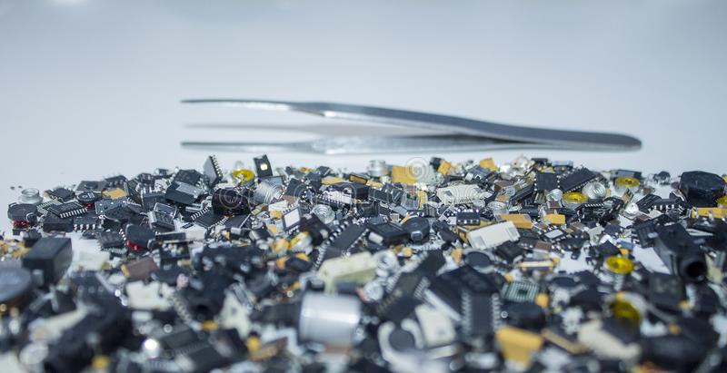 SMT components and tweezers in background. stock photo