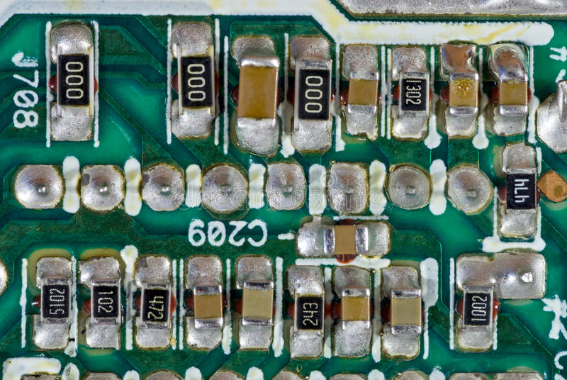 Surface-mount components. On printed circuit board stock photos
