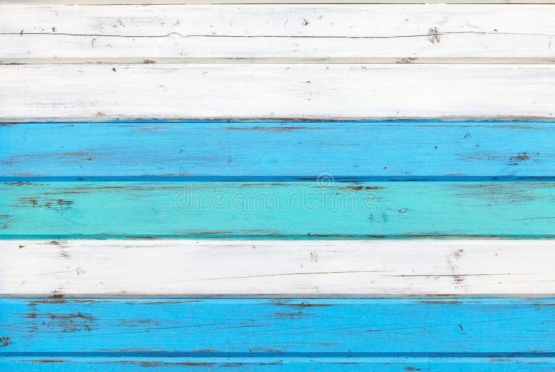 Surface of the old boards painted in white and blue stock image