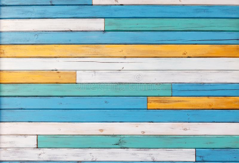 Surface of the old boards painted in white, yellow and blue royalty free stock photos