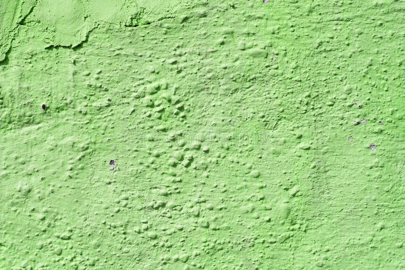 Surface of peeling paint, cracked plaster. Green colour stock images