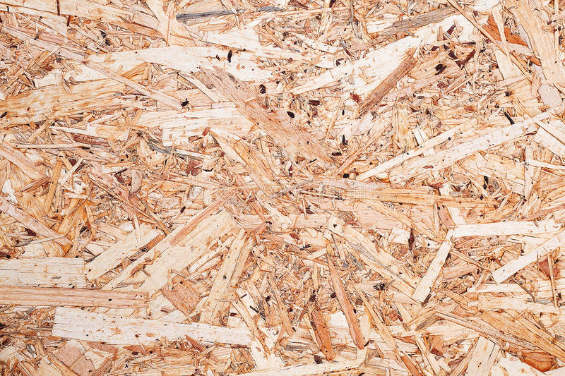 Surface of the pressed wood-shaving plate. Made of the remains of processing of a tree royalty free stock images