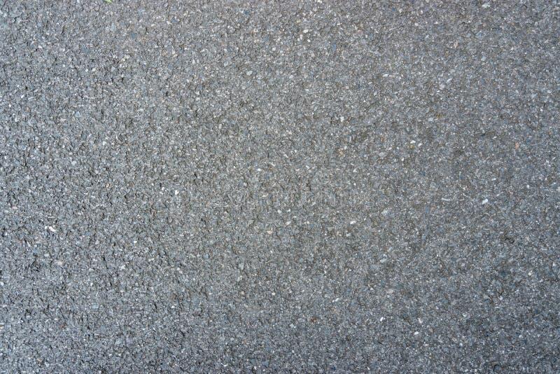 Surface rugueuse du fond concret d'asphalte noir Route grise sans couture photographie stock libre de droits