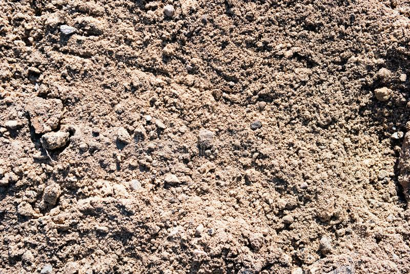 Surface of sand with earth and stones royalty free stock photos