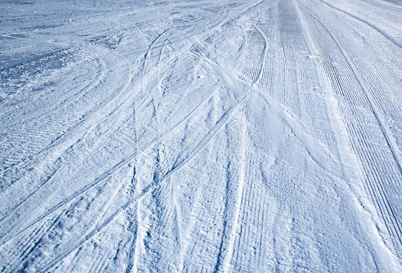 Surface of the ski area with grooves. Background or texture surface of the ski area with grooves stock photos