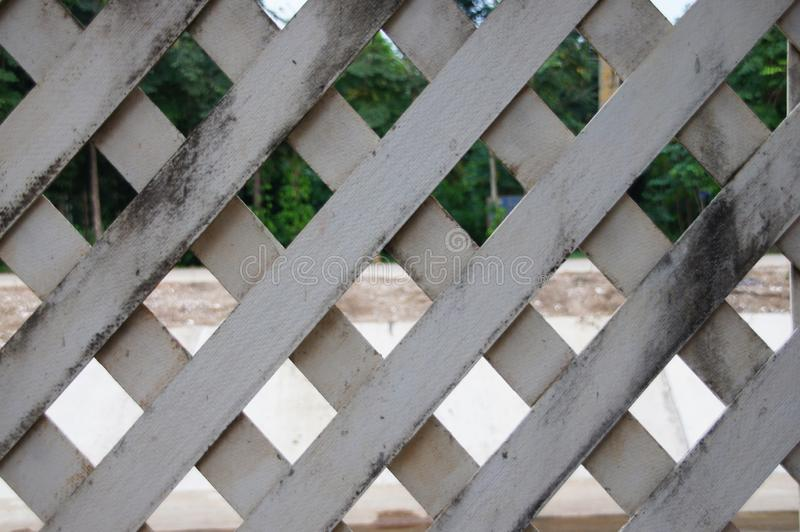 The surface of the slat wall is old. Picture of lath wall surface with old condition background image royalty free stock photos