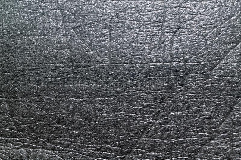 The surface of the soft porous packaging film or dark gray material royalty free stock photos