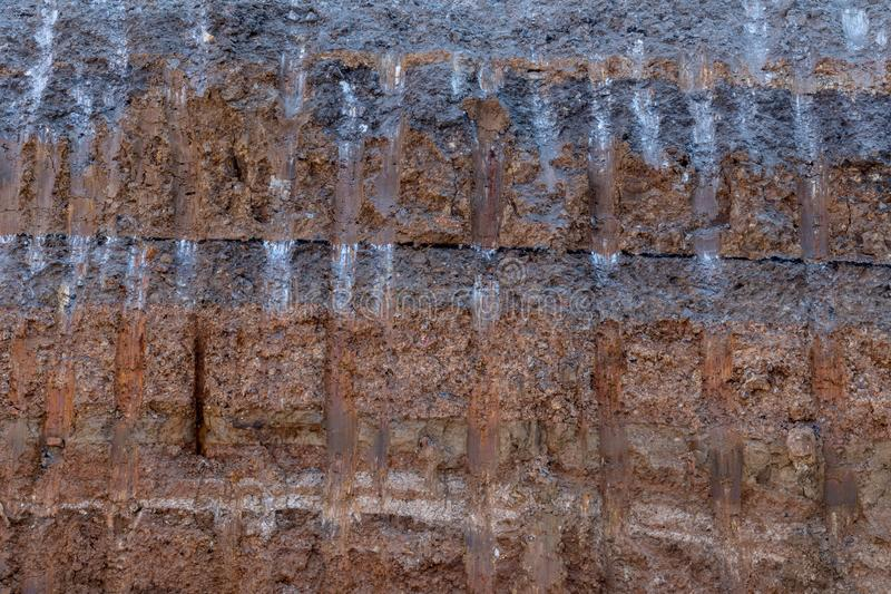 Surface soil layer under the road with digging trails royalty free stock photo
