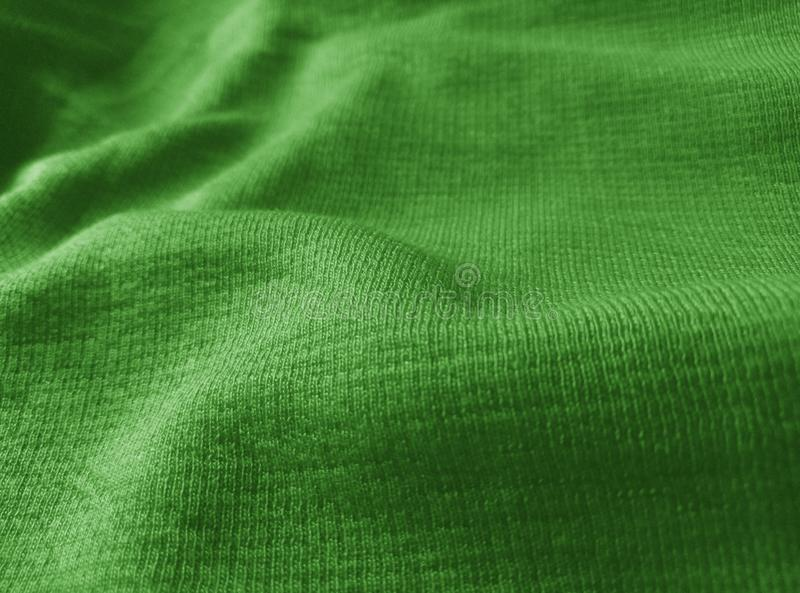 The surface texture of the corrugated green cloth royalty free stock photo