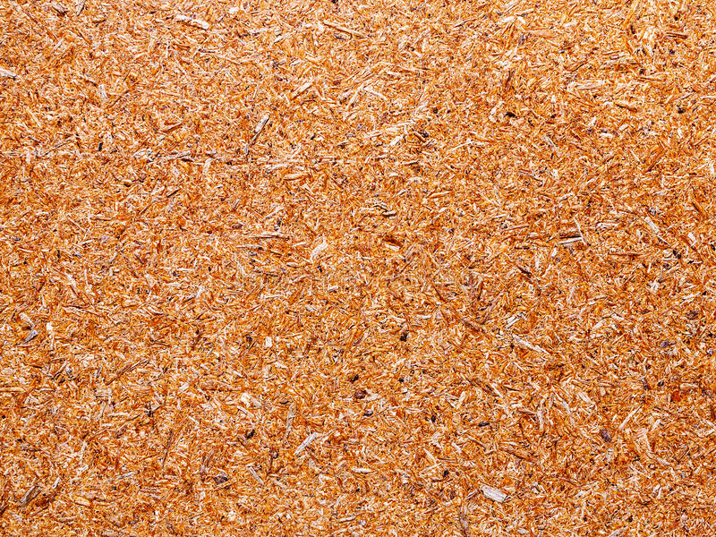 Surface texture of QSB sheet. Surface texture of QSB or OSB sheet for use as a background. Consists of pressed wood chips and resin royalty free stock image