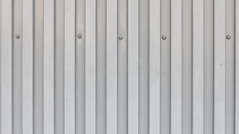 Surface Of Trapezoidal Metal Sheet With Bolts Stock Photo