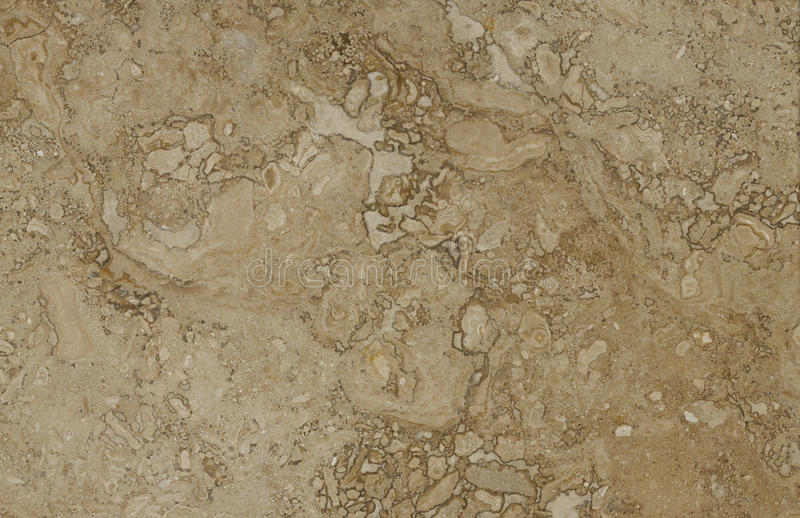 Surface of the travertine. Beige colour. royalty free stock image