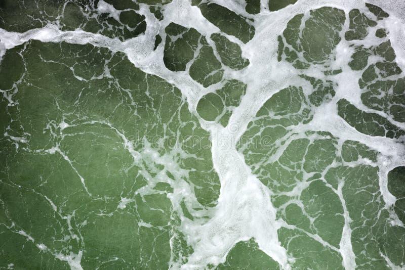 Surface verte d'océan photographie stock