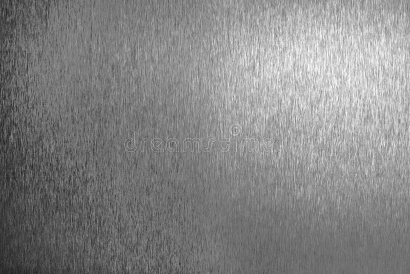 Surface vide brillante en m?tal argent?, fond m?tallique brillant monochrome, fin noire et blanche balay?e de contexte de feuille image libre de droits