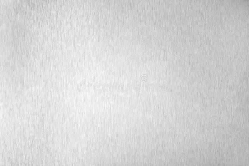 Surface vide brillante en m?tal argent?, fond m?tallique brillant monochrome, fin noire et blanche balay?e de contexte de feuille image stock
