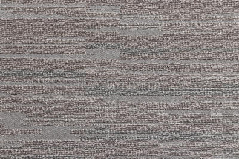 The surface of the Wallpaper with a pattern of horizontal stripes. Different. The surface of non-woven Wallpaper with a pattern of horizontal stripes. The stock photos