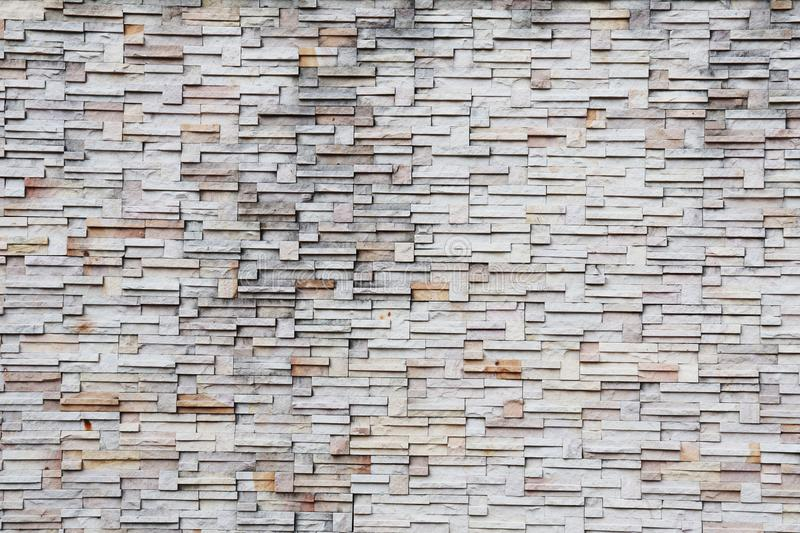 Surface white wall of stone wall background stock image