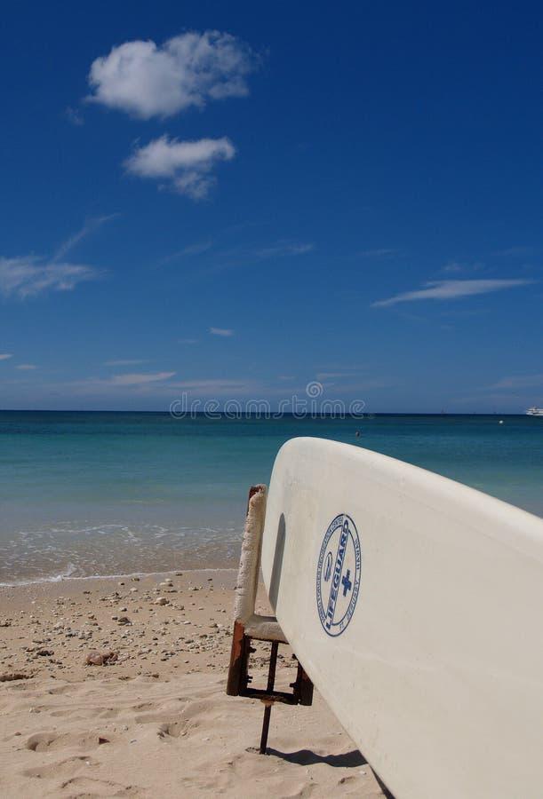 Surfboard on beach in hawaii royalty free stock photos