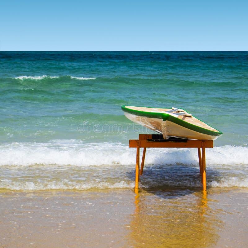 Surfboard on the beach. Hawaiian surfboard on the beach of the Mediterranean sea in Israel stock images