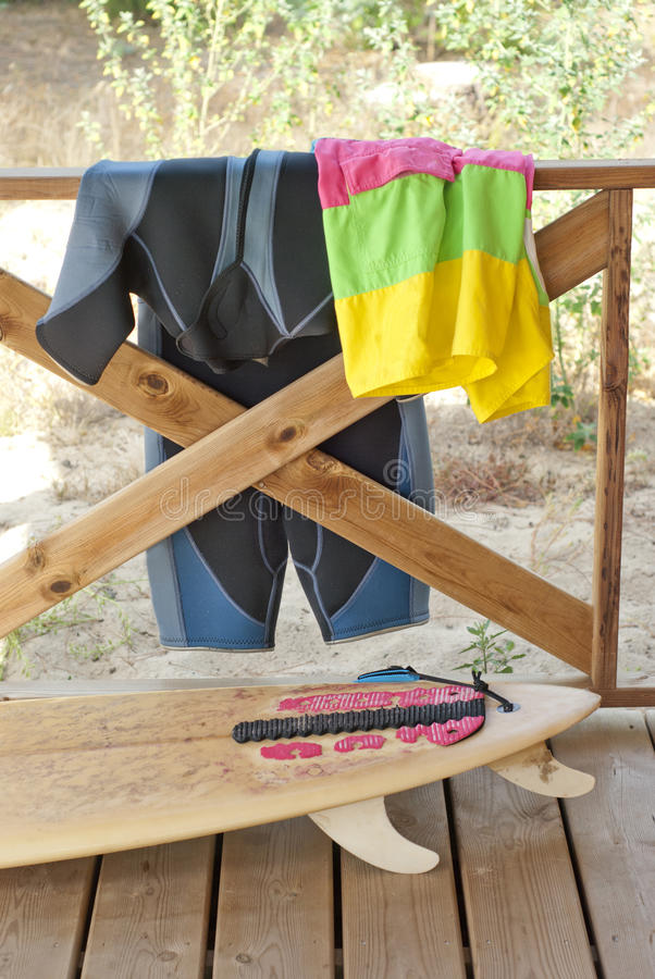 Surfboard and equipment on balcony of house stock photos