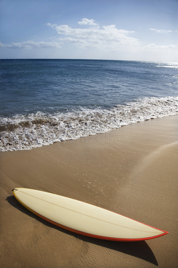 Surfboard on Maui beach. royalty free stock image