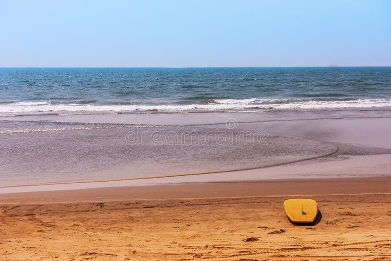 Surfboard on tropical beach royalty free stock image