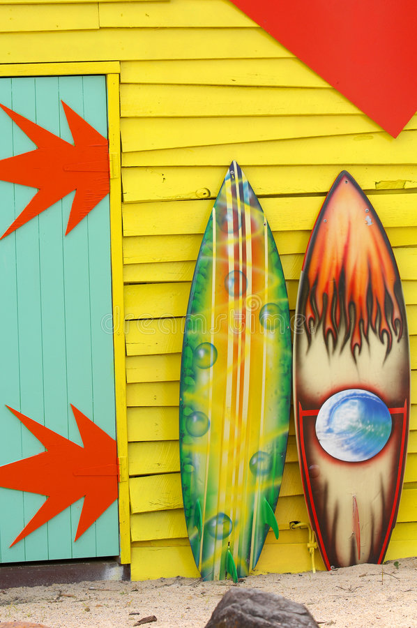 Surfboards. Colorful painted surfboards outdoors leaning on beach shack royalty free stock photos