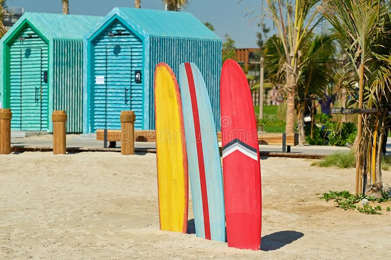 Surfboards and bathing cabins in Dubai stock image