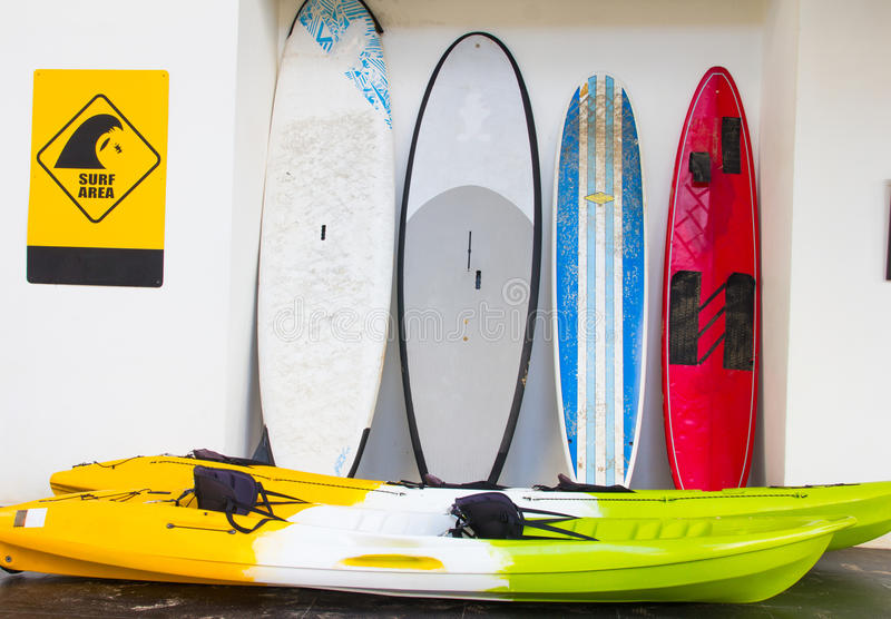 Surfboards. Leaning up against white wall stock photo