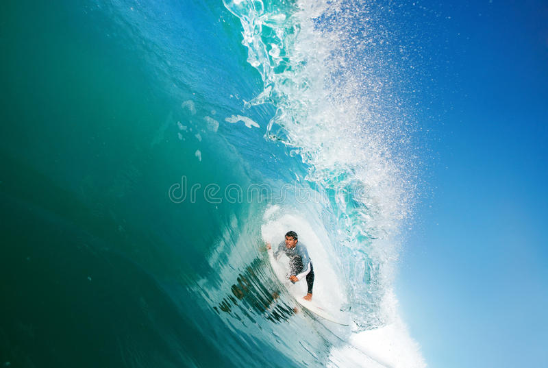 Surfer. In the Tube, Getting Epic Barrel on Blue Ocean Wave stock images