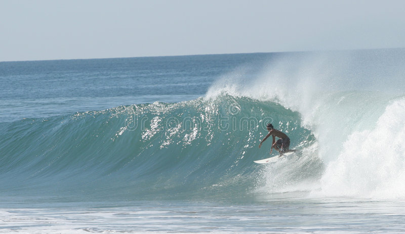 Surfer. Riding the wave royalty free stock images