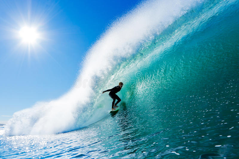 Surfer on Amazing Wave. Surfer on Perfect Blue Wave in the Barrel, Epic Tube royalty free stock photos