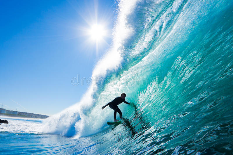 Surfer on Amazing Wave. Surfer on Perfect Blue Wave in the Barrel, Epic Tube stock photography