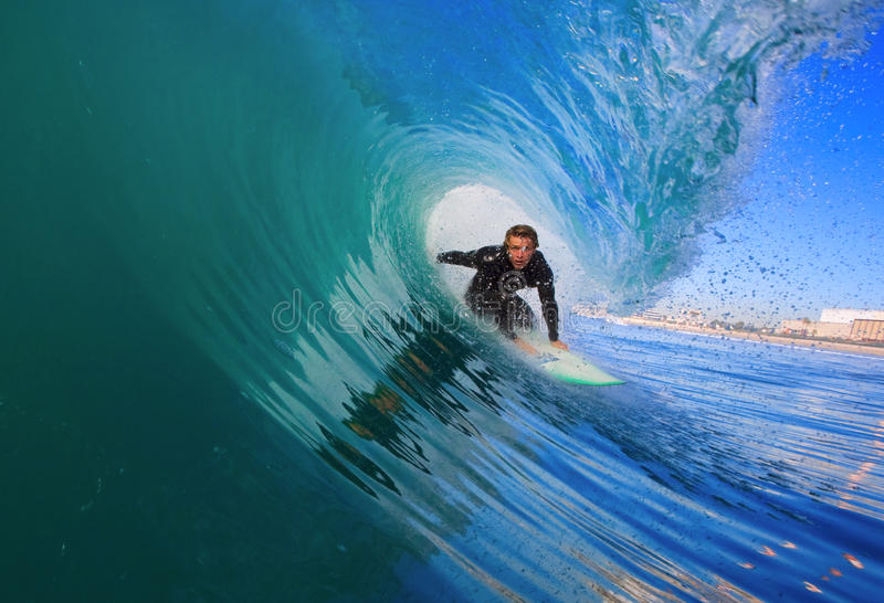 Surfer in the Barrel. Surfer Getting Epic Barrel on Blue Wave in California royalty free stock photography