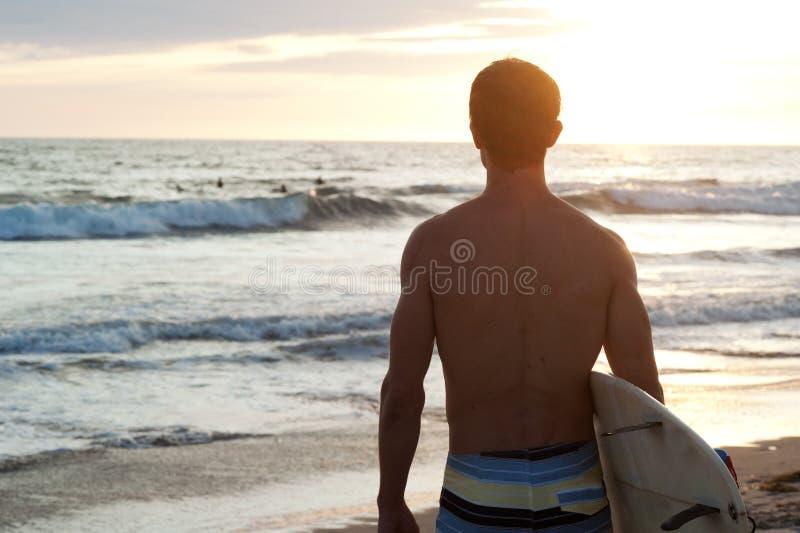 Surfer At The Beach Stock Photos