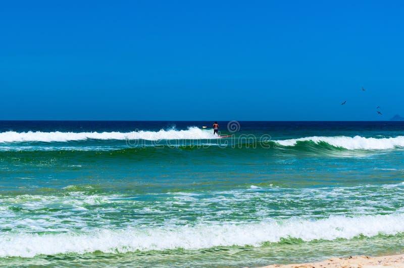 Surfer on the Beach in Barra da Tijuca, Rio de Janeiro royalty free stock photos