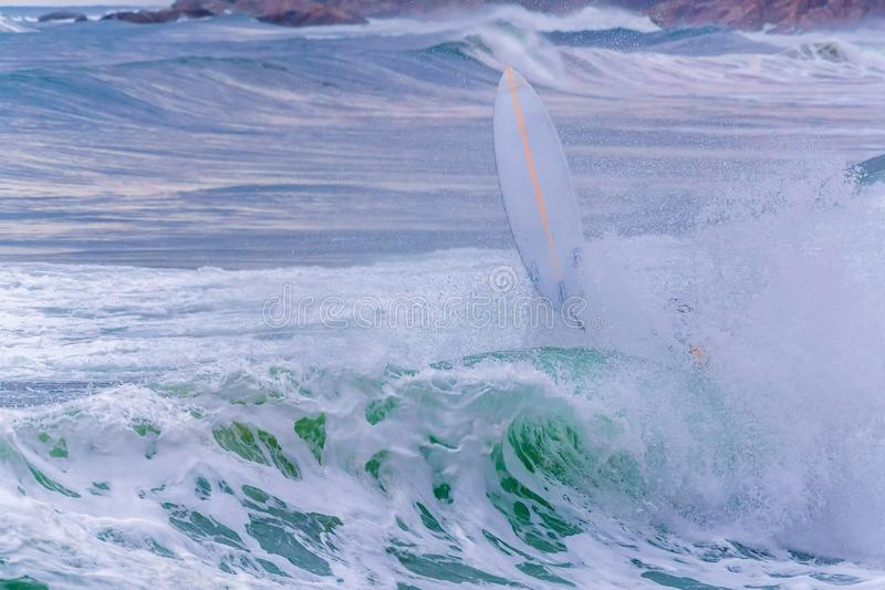 Surfer in the big waves in a spanish ocean, in Costa Brava near the town Palamos stock image