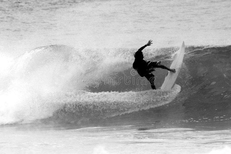Surfer in black and white, North Shore, Hawaii. Black and white photograph of a surfer making a cutback at a surf break on the North Shore of Oahu, Hawaii royalty free stock photo