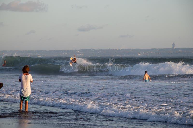 Surfer at Canggu Echo Beach in Bali Indonesia riding wave stock photo