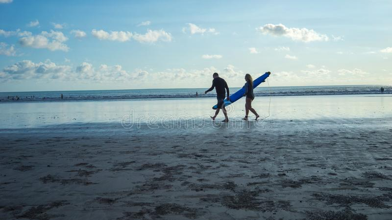 Surfers are going to play waves in the beach area, Kuta Beach-Indonesia stock photography