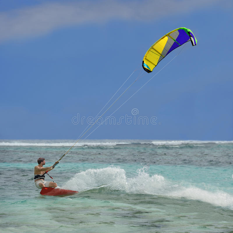 Surfer. Speed, splashes, colorful kite stock images