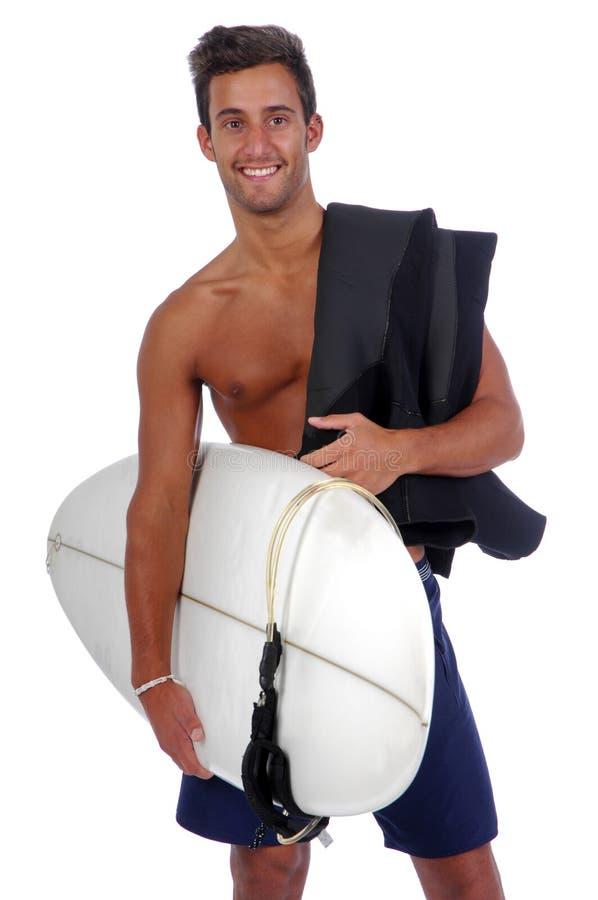Surfer die een surfplank houdt royalty-vrije stock fotografie