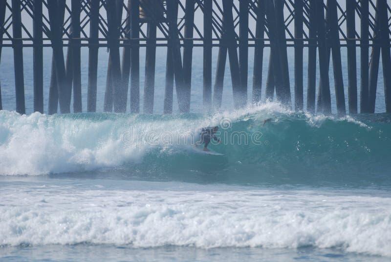 Surfer enjoying the barrel royalty free stock images
