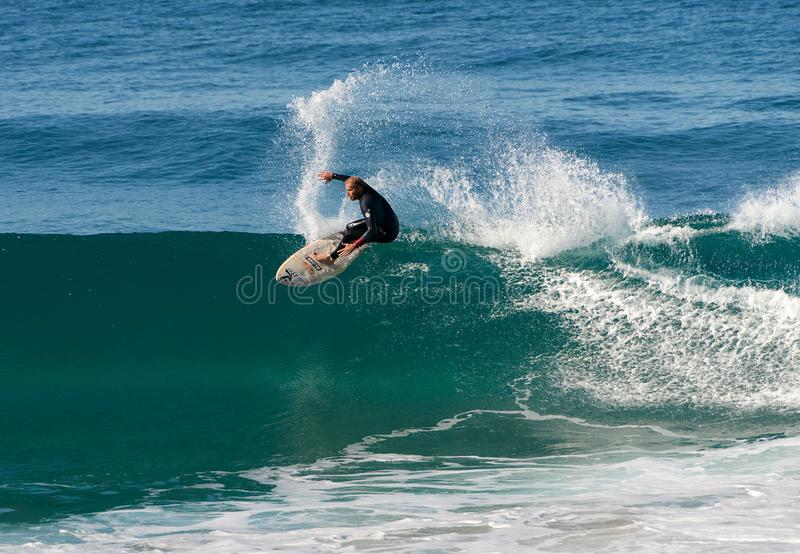 Surfer executing a frontside top-turn off-the-lip at Iluka. stock photo